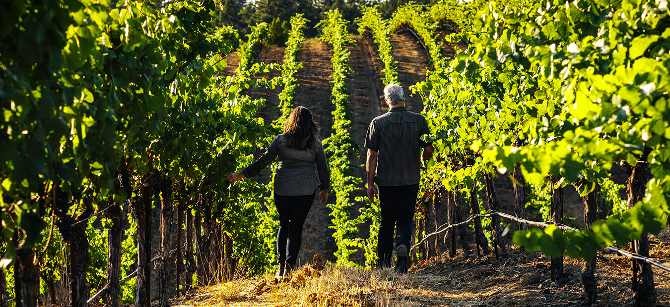 Maggy Hawk Winemakers walking in a vineyard